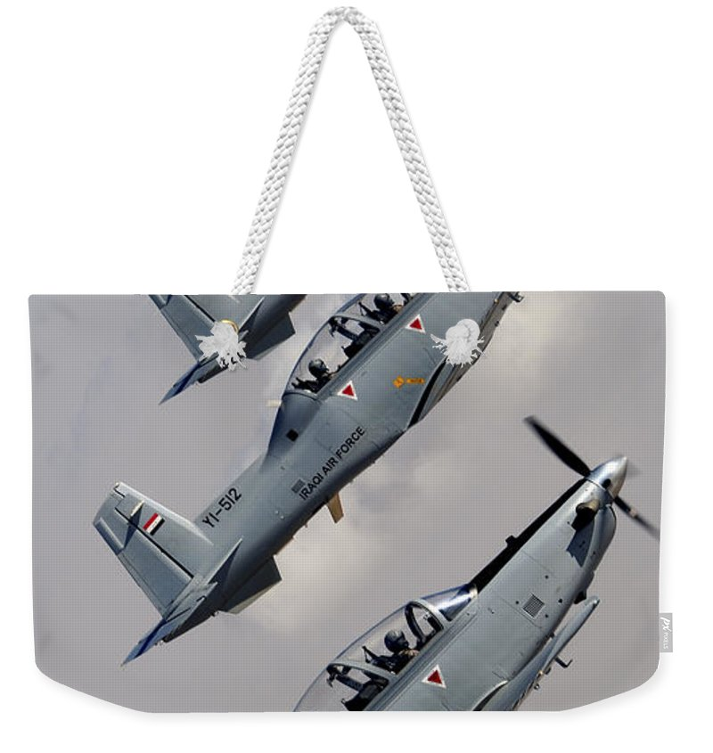 Trainer Weekender Tote Bag featuring the photograph A Formation Of Iraqi Air Force T-6 by Stocktrek Images
