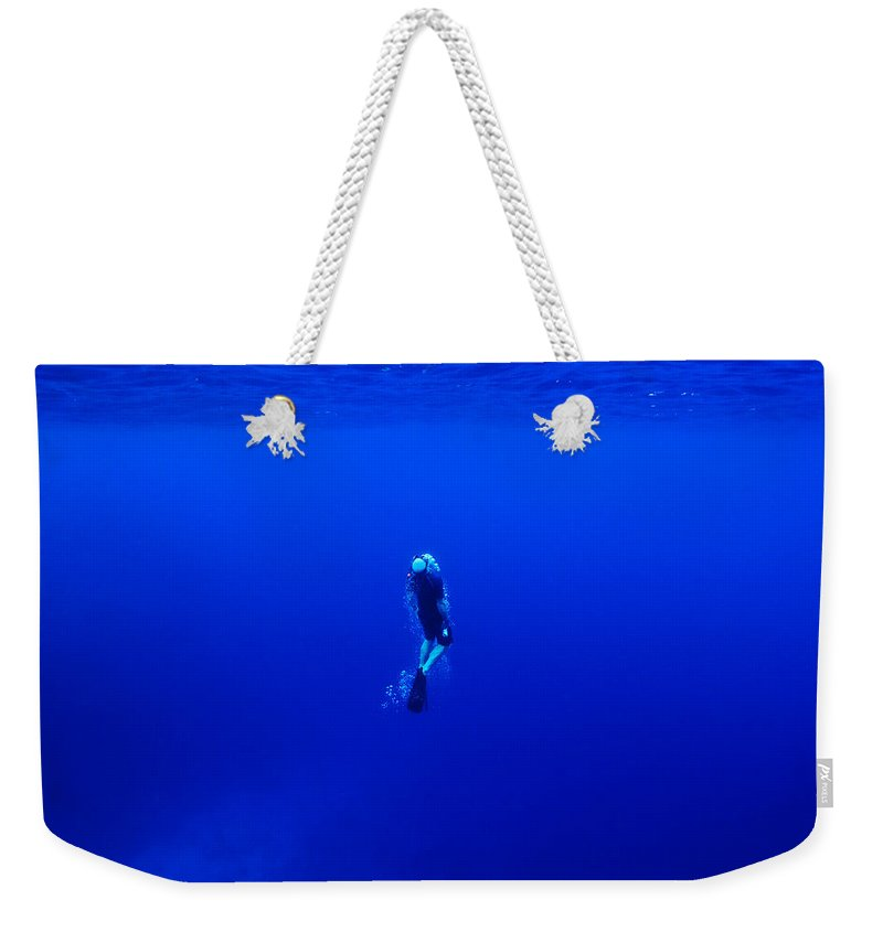 Photography Weekender Tote Bag featuring the photograph A Free Diver Exhales by Jason Edwards