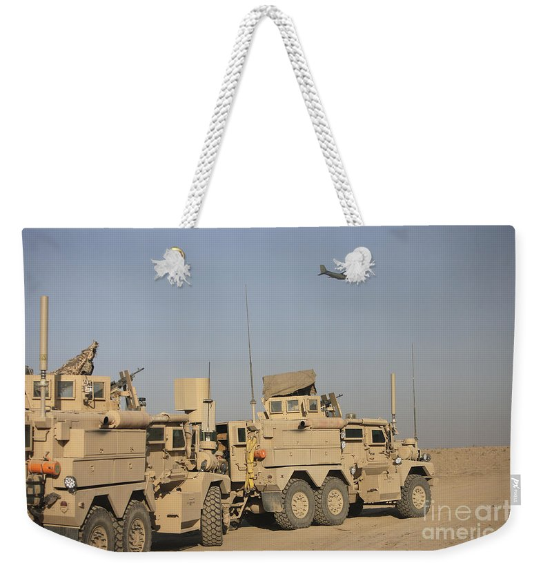 Kunduz Weekender Tote Bag featuring the photograph A German Transall C-160 Flies Over Two by Terry Moore