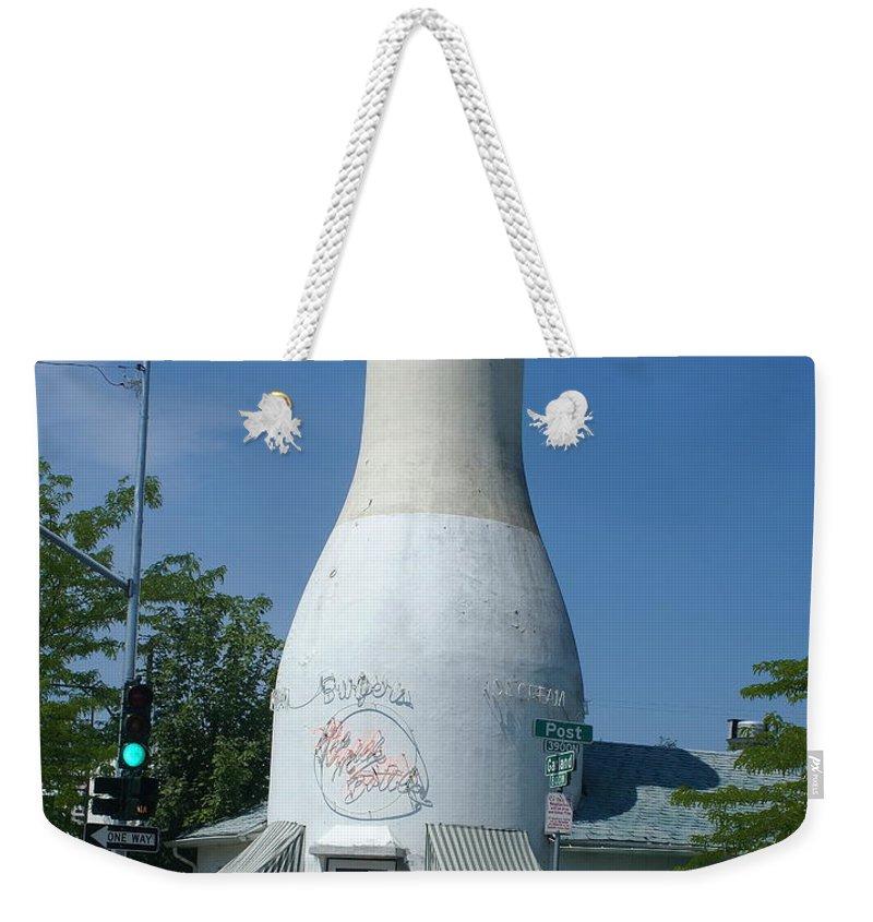 Spokane Weekender Tote Bag featuring the photograph A Giant Milk Bottle In Spokane by Ben Upham III
