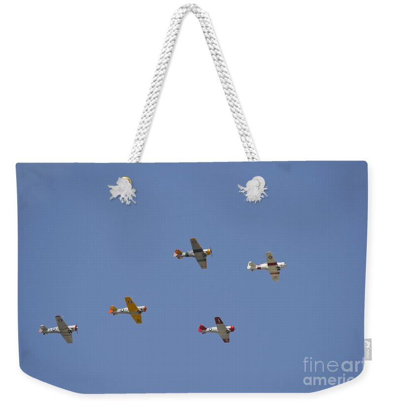 Aviation Weekender Tote Bag featuring the photograph A Group Of Restored Vintage Warbirds by Stocktrek Images