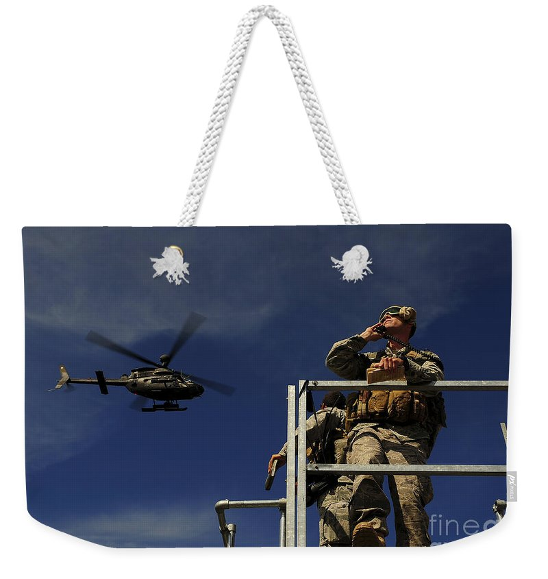 Sky Weekender Tote Bag featuring the photograph A Joint Terminal Attack Controller by Stocktrek Images