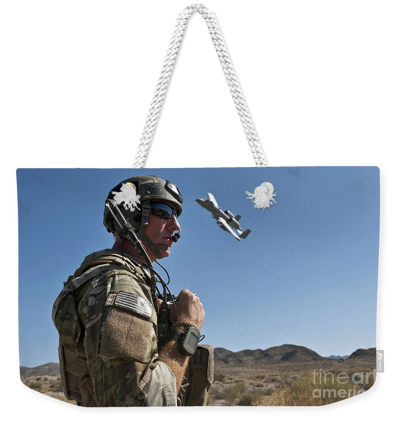 A-10 Thunderbolt Weekender Tote Bag featuring the photograph A Joint Terminal Attack Controller Uses by Stocktrek Images