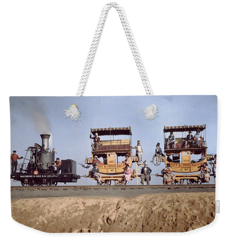 Day Weekender Tote Bag featuring the photograph A Locomotive And Two Coaches by Charles Martin