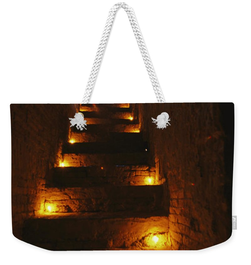 Asia Weekender Tote Bag featuring the photograph A Narrow Staircase Lit With Candles by Richard Nowitz