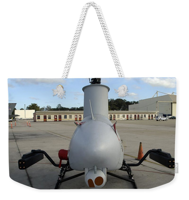 Virginia Weekender Tote Bag featuring the photograph A Northrop Grumman Rq-8 Fire Scout by Stocktrek Images