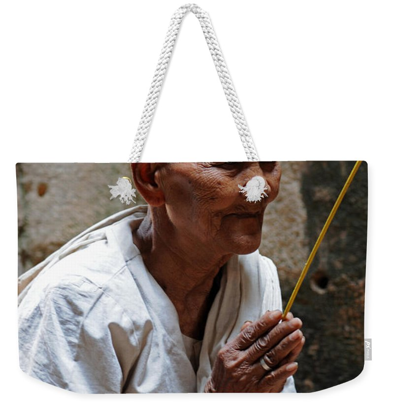 Nun Weekender Tote Bag featuring the photograph A Nuns Devotions by Vivian Christopher