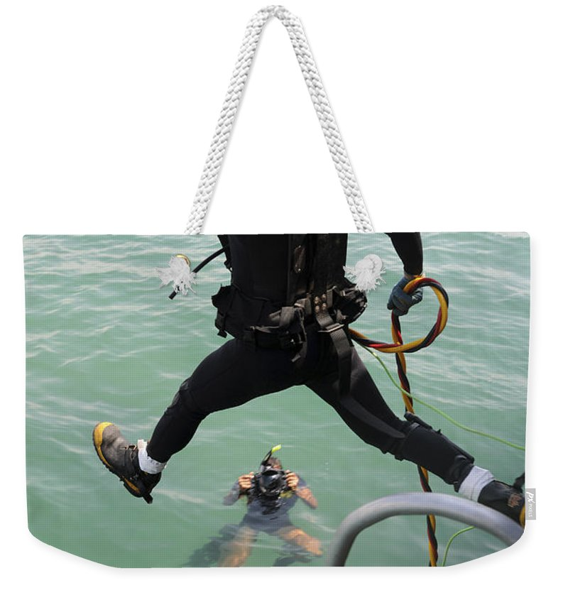 Vietnam Weekender Tote Bag featuring the photograph A Photographer Documents A Navy Diver by Stocktrek Images