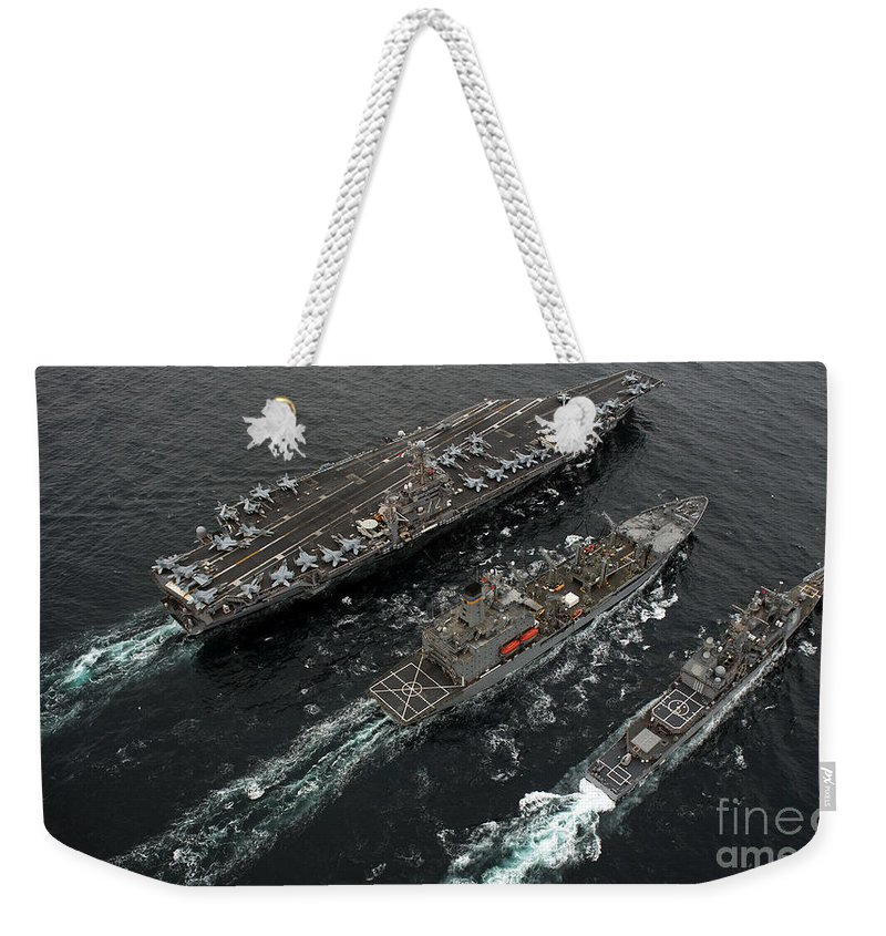 Us Navy Weekender Tote Bag featuring the photograph A Replenishment At Sea Between Uss by Stocktrek Images