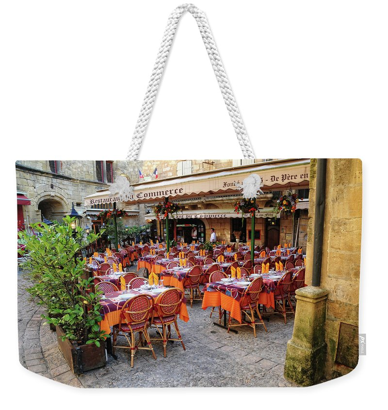 Restaurant Weekender Tote Bag featuring the photograph A Restaurant In Sarlat France by Dave Mills