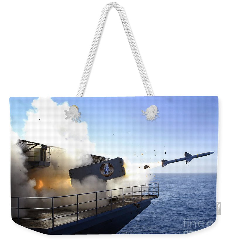 Uss Abraham Lincoln Weekender Tote Bag featuring the photograph A Rim-7 Sea Sparrow Missile Launches by Stocktrek Images