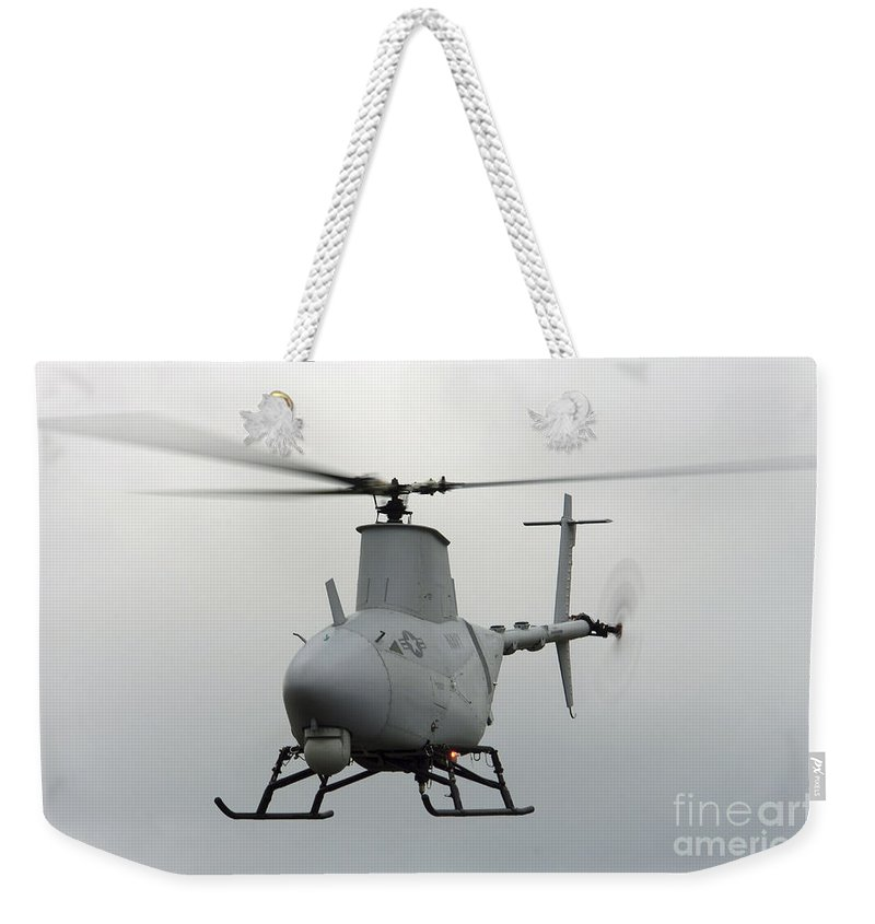 Saint Inigoes Weekender Tote Bag featuring the photograph A Rq-8a Fire Scout Unmanned Aerial by Stocktrek Images