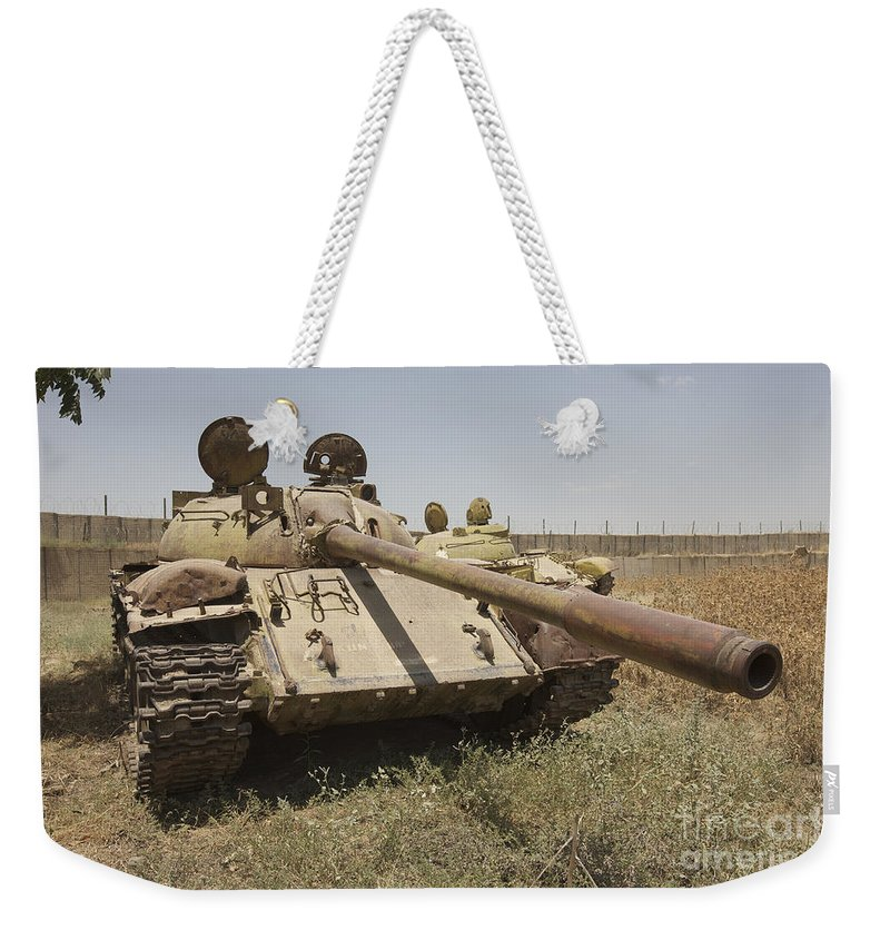 Cannon Weekender Tote Bag featuring the photograph A Russian T-55 Main Battle Tank by Terry Moore