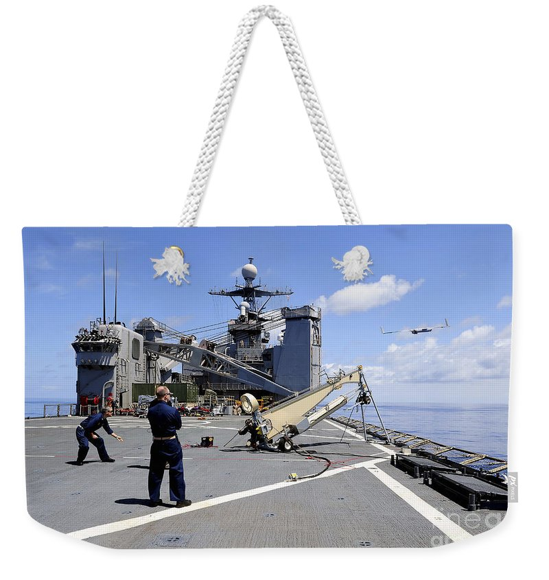 Military Weekender Tote Bag featuring the photograph A Scan Eagle Uav Is Launched by Stocktrek Images