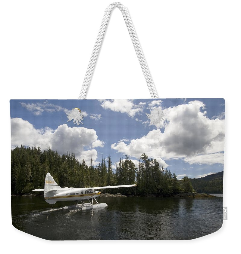 Nobody Weekender Tote Bag featuring the photograph A Seaplane Taking Off From Vancouver by Phil Schermeister