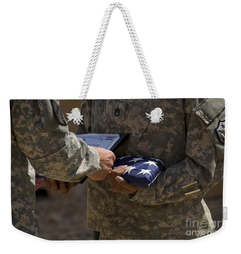 Airmen Weekender Tote Bag featuring the photograph A Soldier Is Presented The American by Stocktrek Images