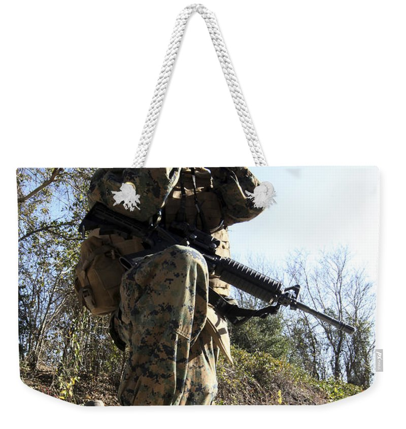 Boot Weekender Tote Bag featuring the photograph A Soldier Looking Through Binoculars by Stocktrek Images
