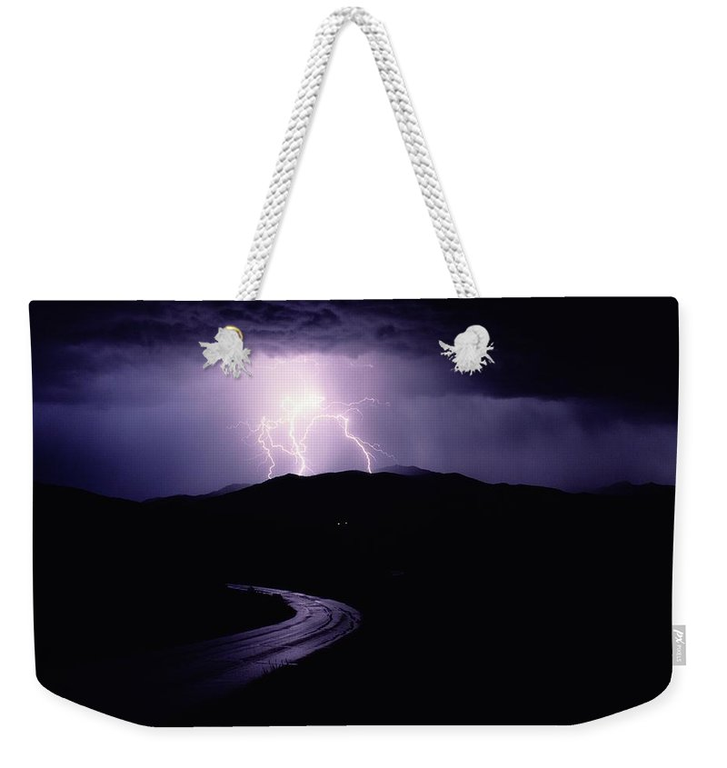 Yellowstone National Park Weekender Tote Bag featuring the photograph A Summer Storm In Yellowstone National by Raymond Gehman