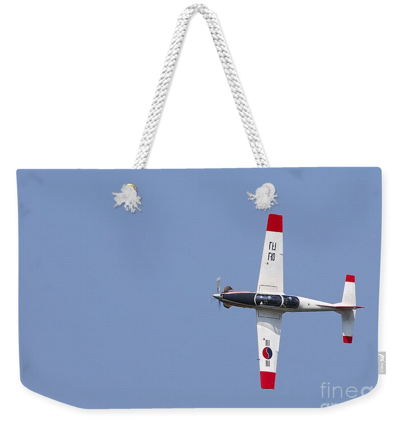 Air Force Weekender Tote Bag featuring the photograph A T-50 Golden Eagle Aircraft In Flight by Stocktrek Images
