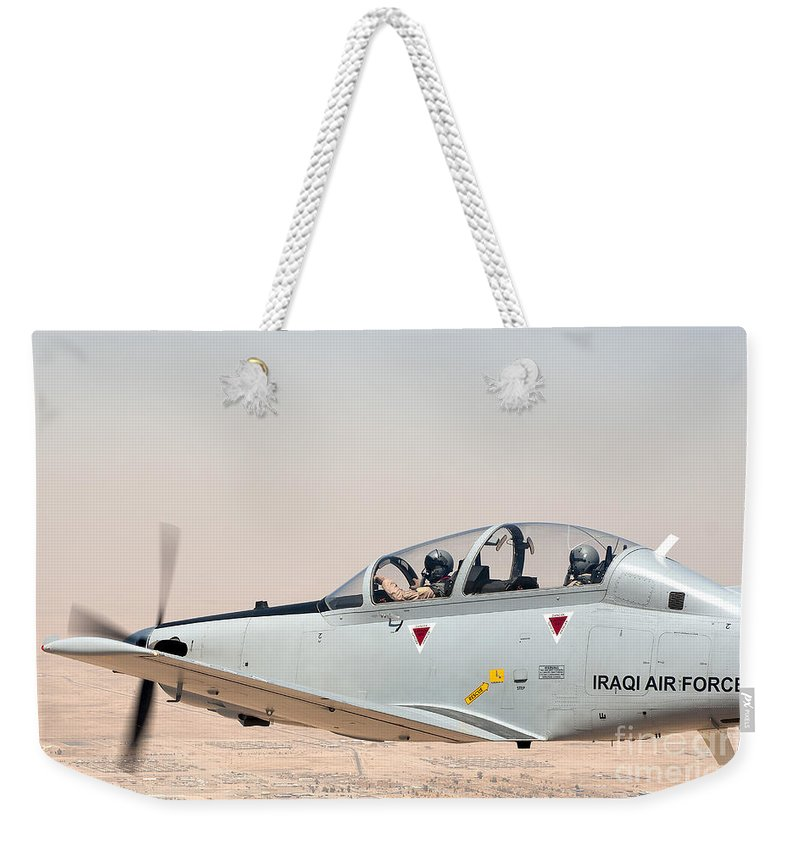 Air Force Weekender Tote Bag featuring the photograph A T-6 Texan Flying Over Camp Speicher by Stocktrek Images