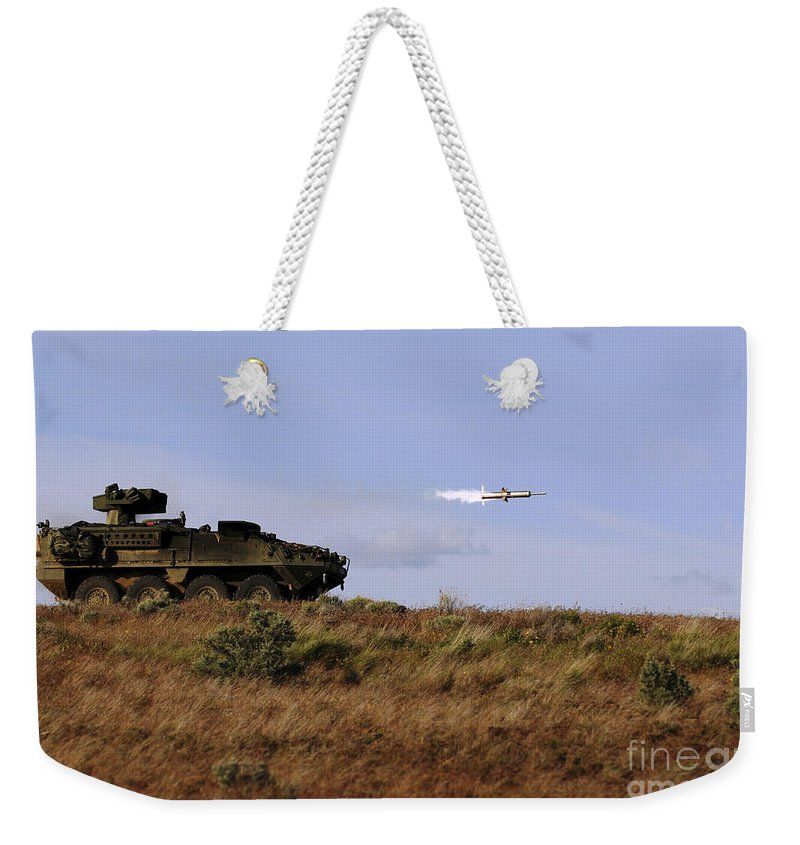 Yakima Training Center Weekender Tote Bag featuring the photograph A Tow Missile Is Launched From An by Stocktrek Images