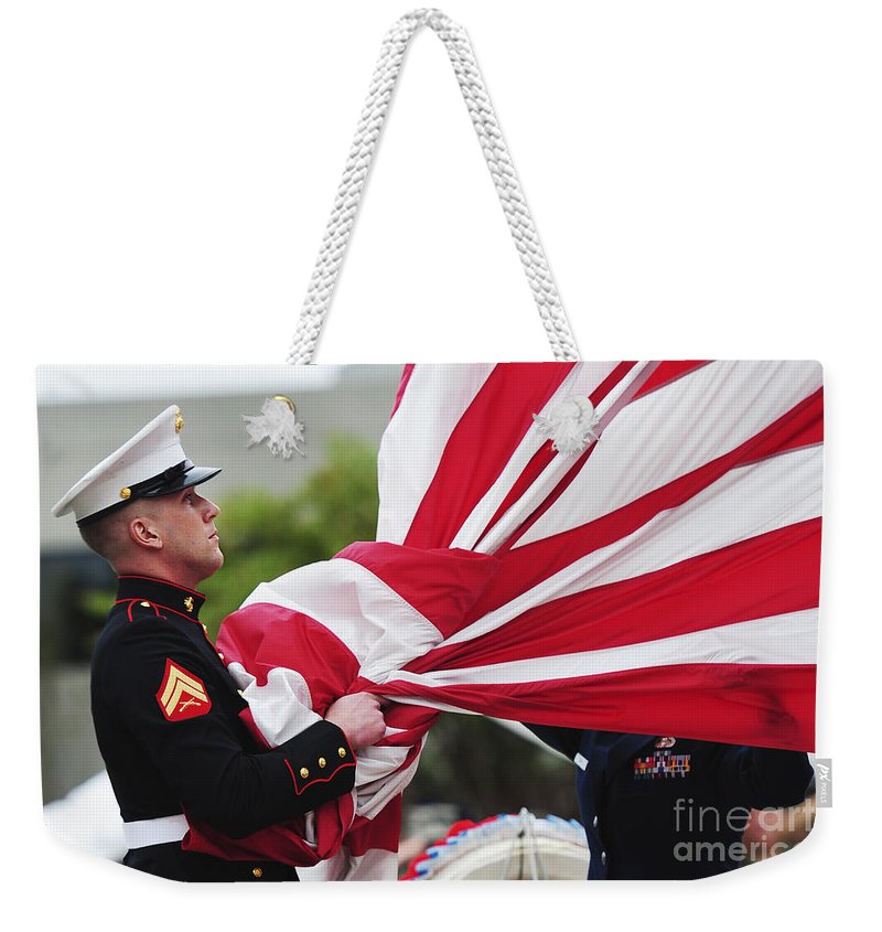 Ceremony Weekender Tote Bag featuring the photograph A United States Marine Takes by Stocktrek Images