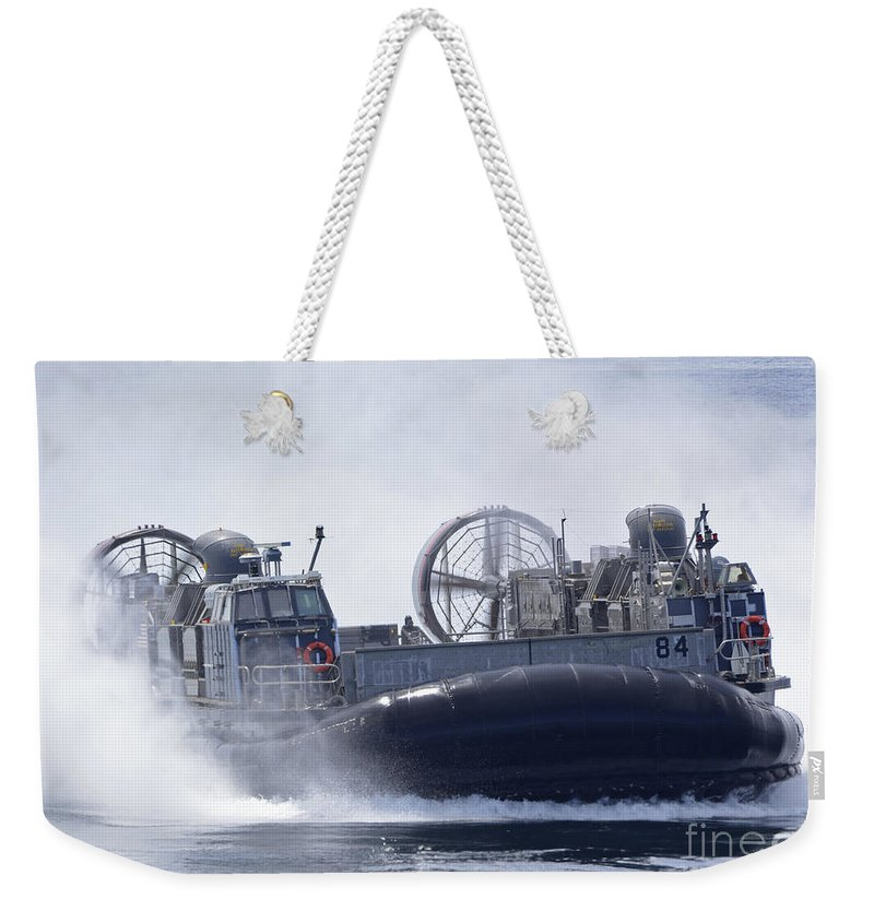 Military Weekender Tote Bag featuring the photograph A U.s. Marine Corps Landing Craft Air by Stocktrek Images