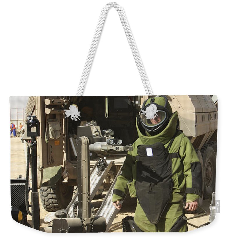 Kunduz Weekender Tote Bag featuring the photograph A U.s. Marine Dressed In A Bomb Suit by Terry Moore