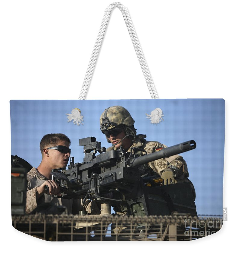Afghanistan Weekender Tote Bag featuring the photograph A U.s. Marine Fires A Gmg Automatic by Terry Moore