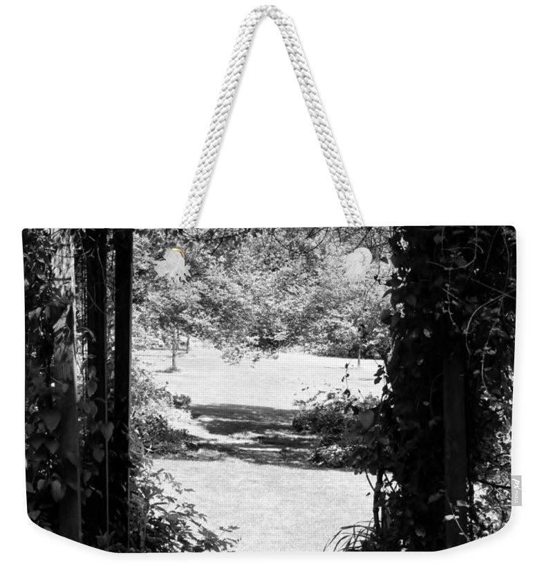 Garden Photographs Weekender Tote Bag featuring the photograph A Walk To Remember by Art Dingo
