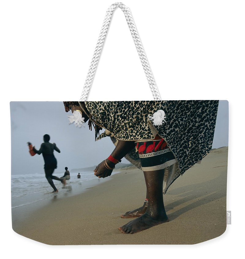 Outdoors Weekender Tote Bag featuring the photograph A Woman Training To Be A Healer Gathers by Chris Johns