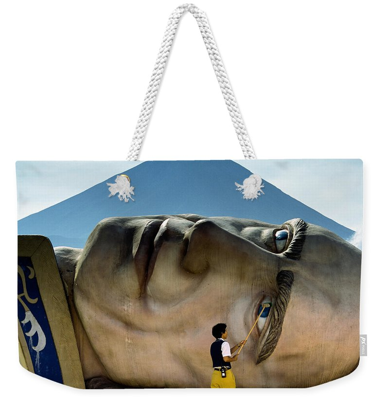 Asia Weekender Tote Bag featuring the photograph A Worker At The Defunct Gullivers by Karen Kasmauski