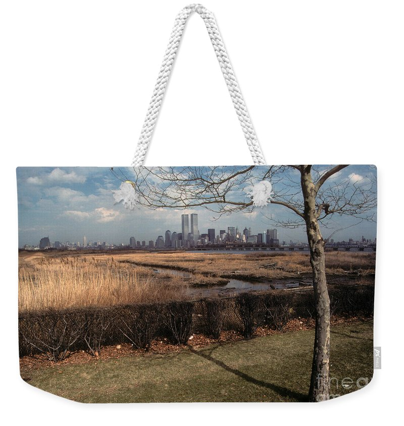 Wtc Weekender Tote Bag featuring the photograph Across The River by Mark Gilman