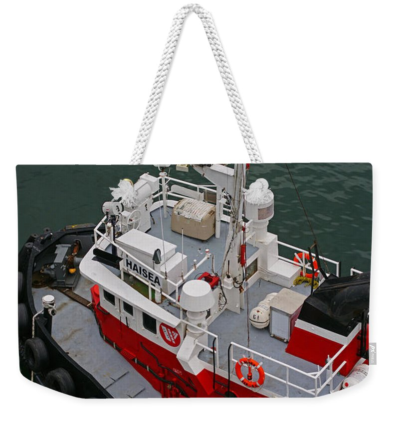 Boats Weekender Tote Bag featuring the photograph Aerial View Of Red Tug by Randy Harris