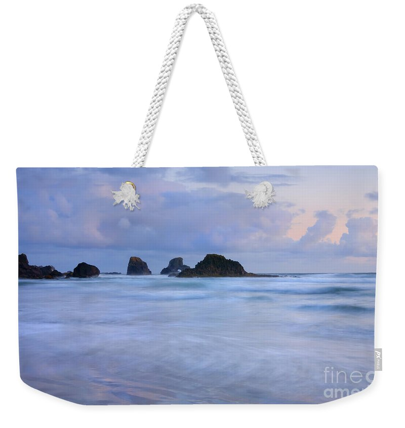 Tides Weekender Tote Bag featuring the photograph Against The Tides by Mike Dawson