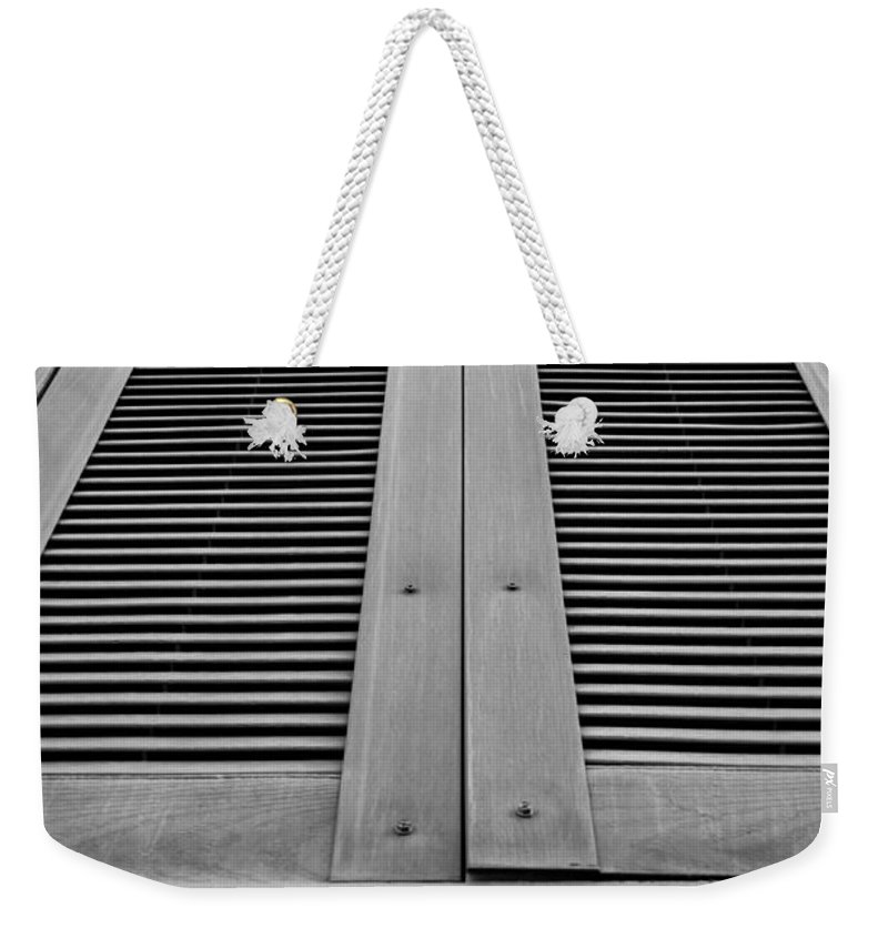 Building Weekender Tote Bag featuring the photograph Aged Shutters by Colleen Coccia