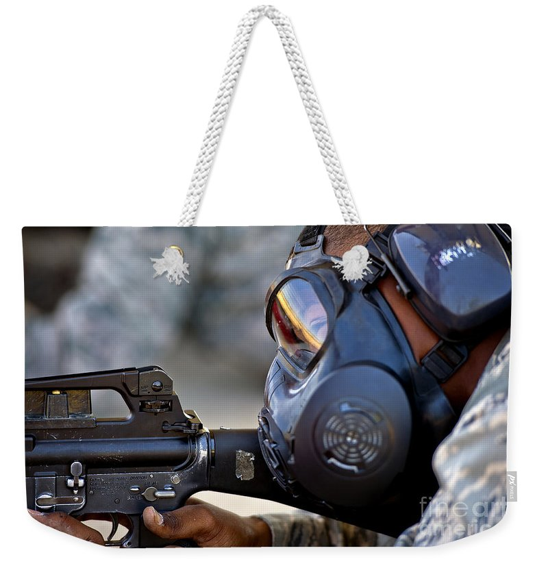 Combat Weekender Tote Bag featuring the photograph Air Force Basic Military Training by Stocktrek Images