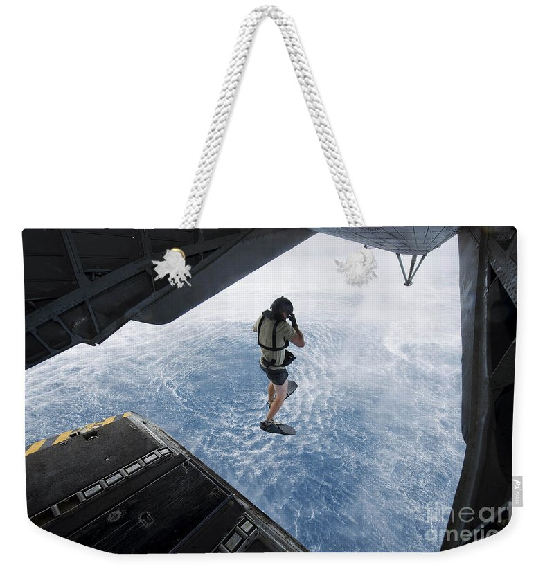 Ch-53e Super Stallion Weekender Tote Bag featuring the photograph Air Force Pararescueman Jumps by Stocktrek Images