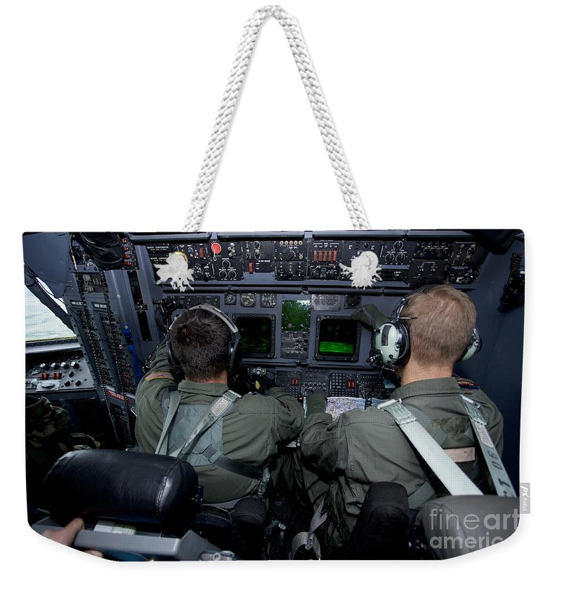 Mc-130 Hercules Weekender Tote Bag featuring the photograph Airmen At Work In A Mc-130h Combat by Gert Kromhout