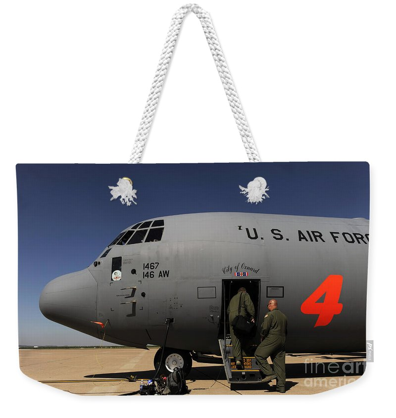 Texas Weekender Tote Bag featuring the photograph Airmen Board A C-130j Hercules At Dyess by Stocktrek Images