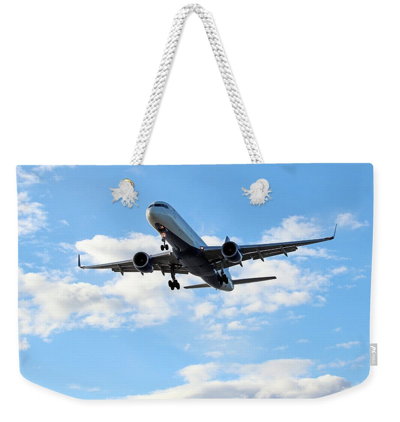Air Weekender Tote Bag featuring the photograph Airplane Landing by Paul Fell