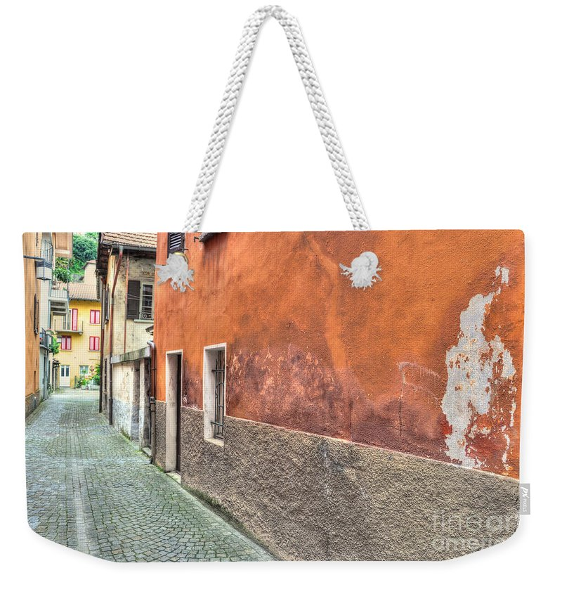 Alley Weekender Tote Bag featuring the photograph Alley by Mats Silvan