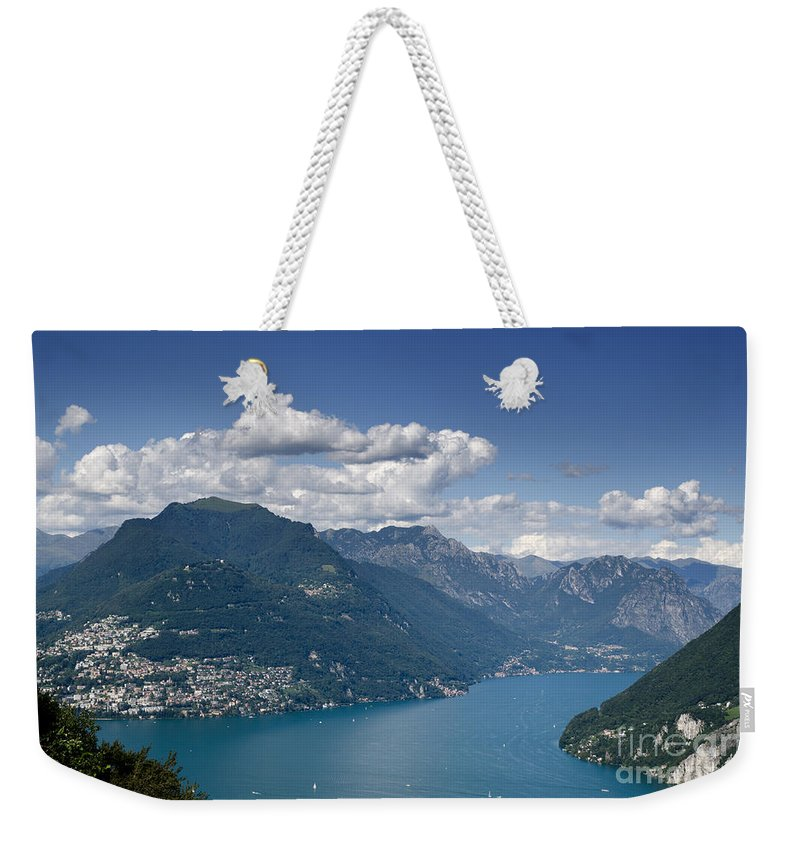 Mountains Weekender Tote Bag featuring the photograph Alpine Lake And Mountains by Mats Silvan