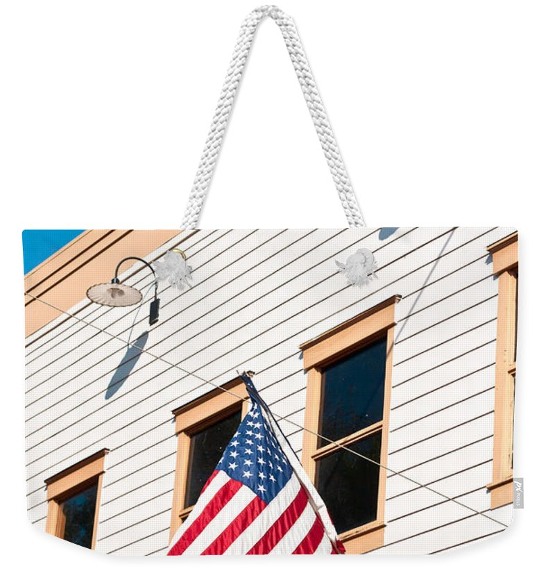 4th Weekender Tote Bag featuring the photograph American Flag by Tom Gowanlock