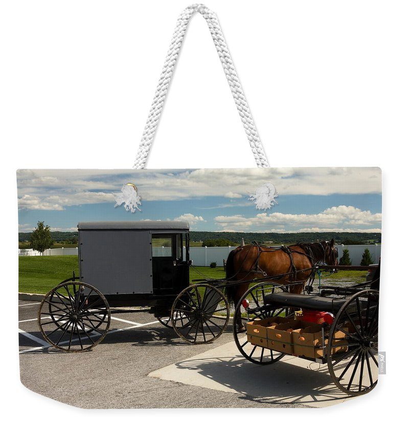 Enclosed Amish Buggy Weekender Tote Bag featuring the photograph Amish Buggy by Sally Weigand