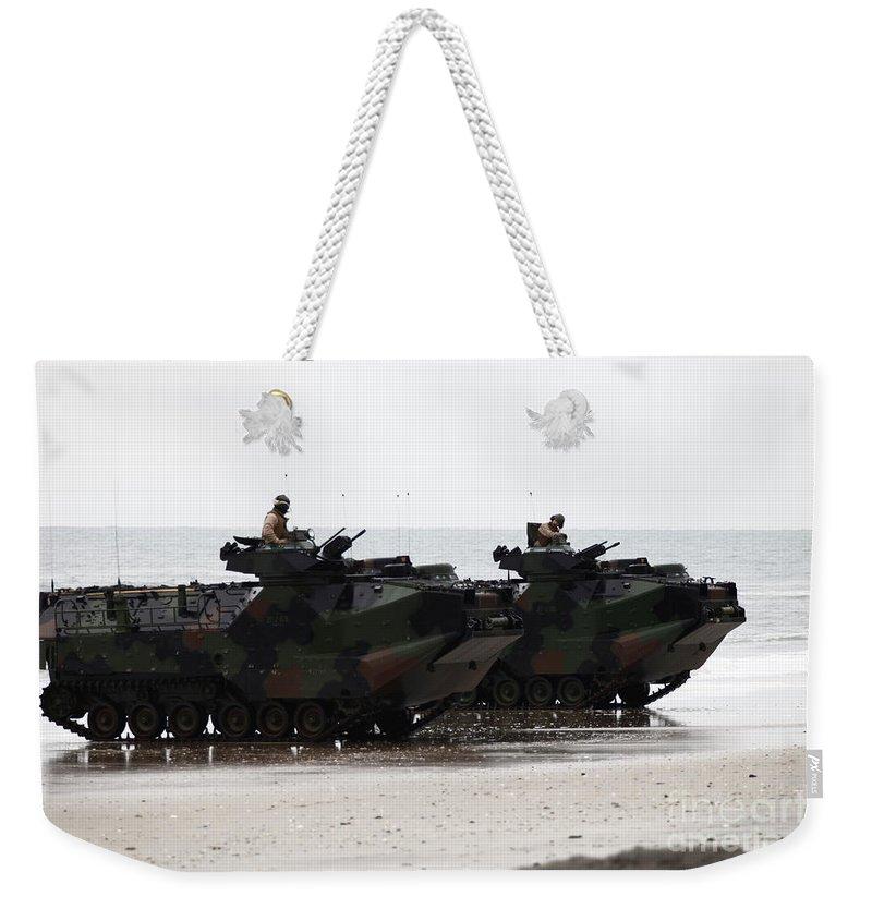 Men Weekender Tote Bag featuring the photograph Amphibious Assault Vehicles Land Ashore by Stocktrek Images