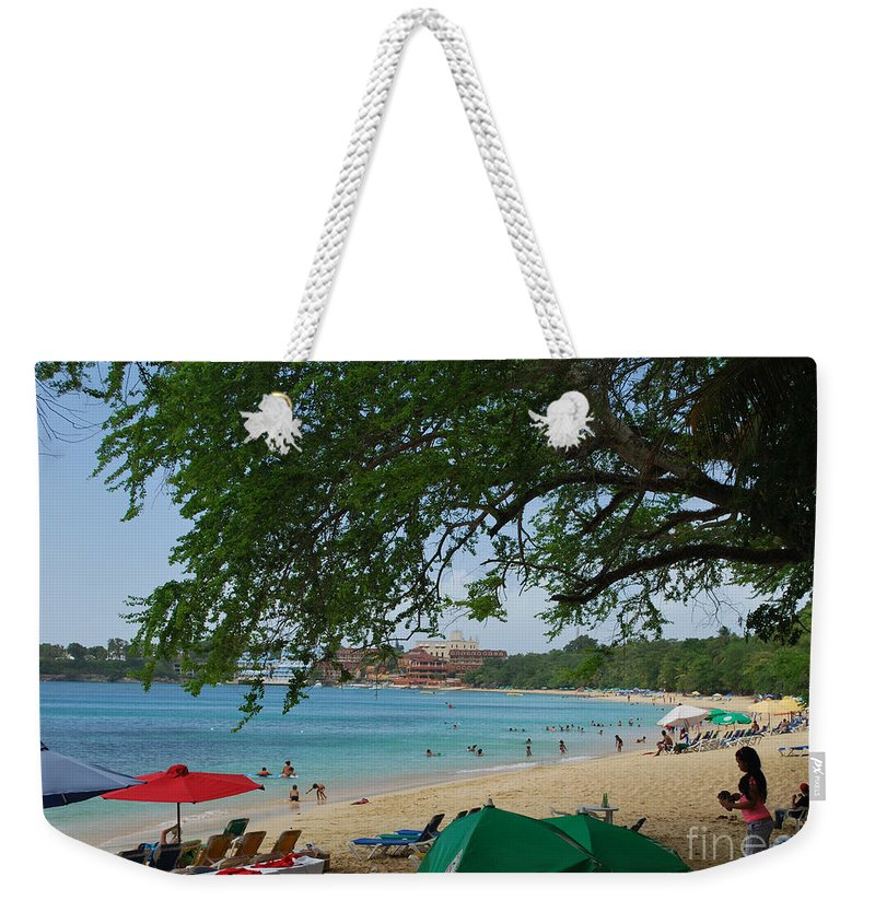 Sosua Weekender Tote Bag featuring the photograph An Active Sosua Beach In Dr by Heather Kirk