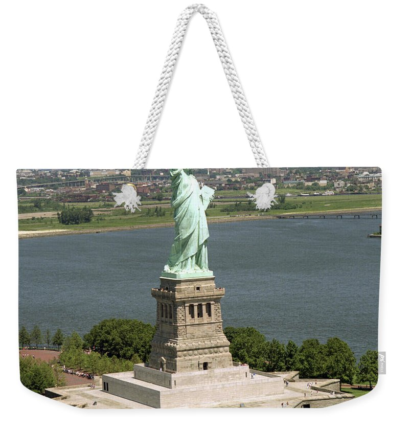 Symbolic Weekender Tote Bag featuring the photograph An Aerial View Of The Statue Of Liberty by Stocktrek Images