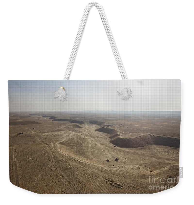 Operation Enduring Freedom Weekender Tote Bag featuring the photograph An Aerial View Of The Wadi Over Kunduz by Terry Moore