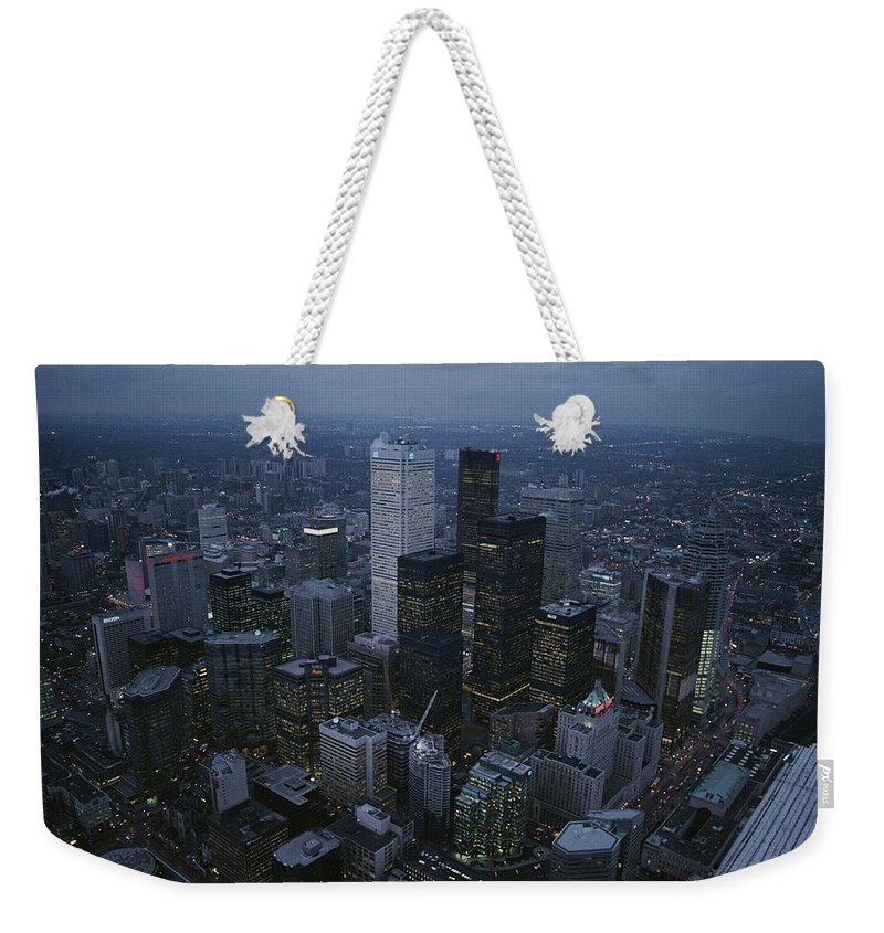 North America Weekender Tote Bag featuring the photograph An Aerial View Of Toronto At Dusk by George F. Mobley